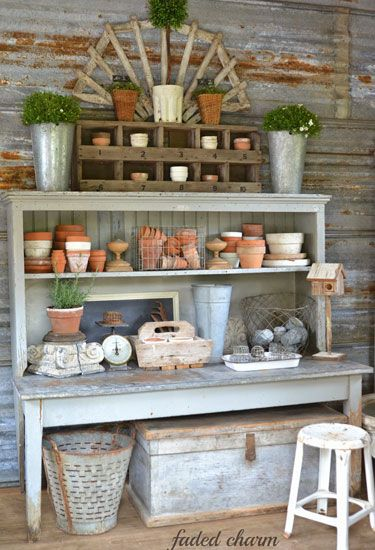 A potting bench holds dozens of terra-cotta pots.