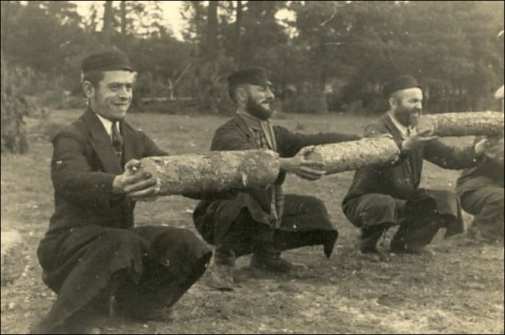 Polish Jews are forced to hold heavy logs while squatting.  This is a classic form of torture and torment the world over.  Not terribly taxing at first, holding the object becomes more and more difficult with every passing minute.  After only a short while, the arm muscles begin to ache and shake.  Finally, the muscles simply give out.  Not a big deal when it's a contest between friends.  A much bigger deal when you continue to live only as long as you can keep the object raised.