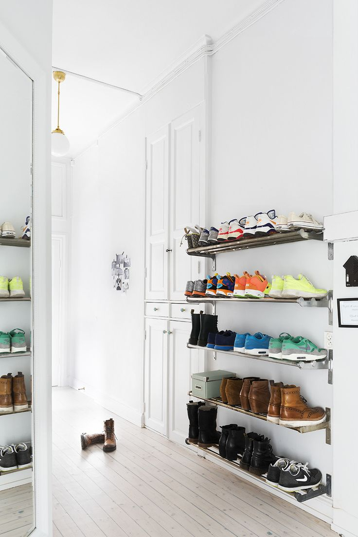 Bright white hallway with entryway shoe storage