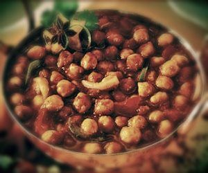 Punjabi Channa Masala - Roasted chickpeas slow cooked in thick masala gravy with cumin, grounded turmeric garnished with fresh coriander only from Jai Ho Indian Restaurant!  #IndainFood #PunjabiFood