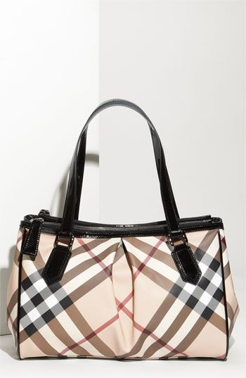 Something about a woman w/ a clean Burberry purse seems so sexy sophisticated