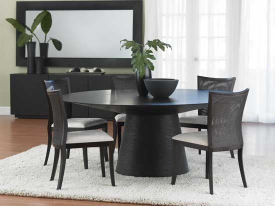 Bradley Round Dining Table from Dania... like pedestal, round.