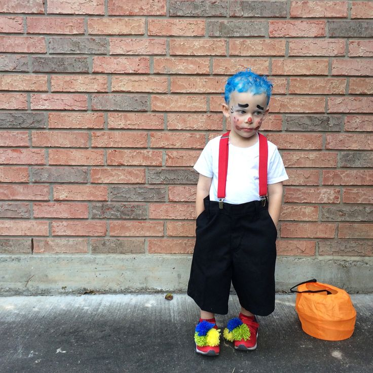 DIY Kids Boy Clown Halloween Costume, Yarn Pom poms, suspenders, big shorts. Pinning my own because it's super easy and I found no other examples.