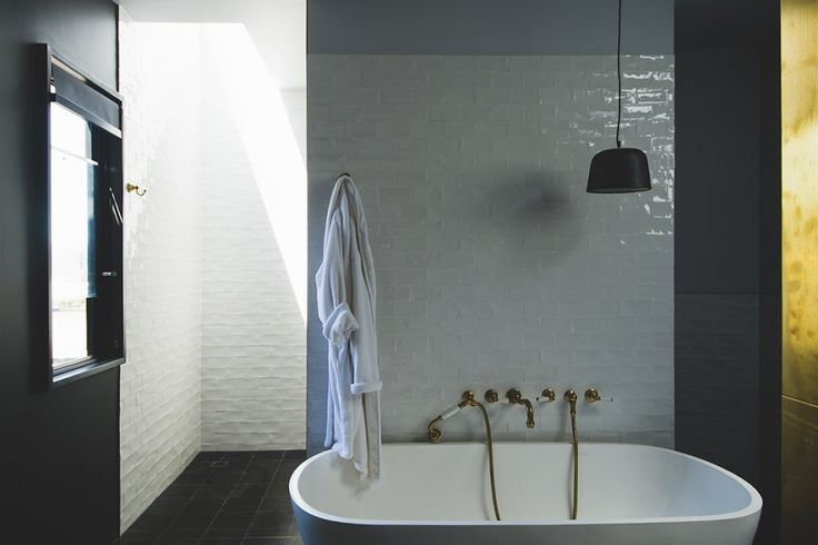 Industrial warehouse bathrooms and kitchen by Surroundings Architecture, designed for living, working and entertaining.   The English Tapware Company