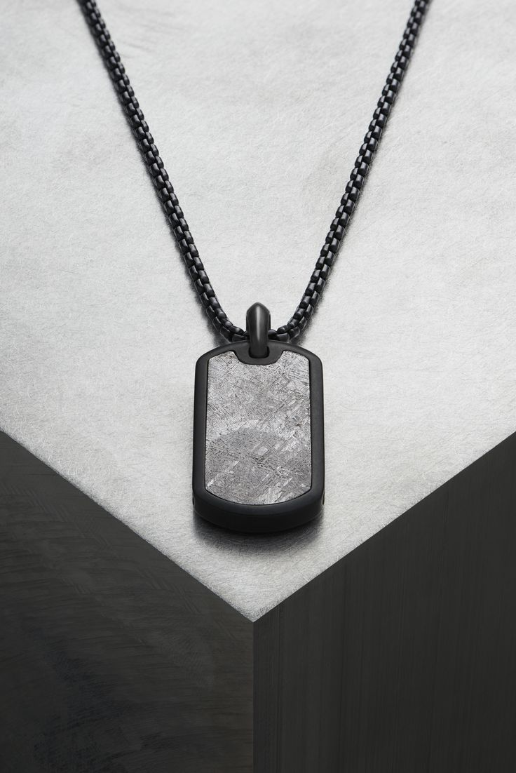 Meteorite tag necklace.