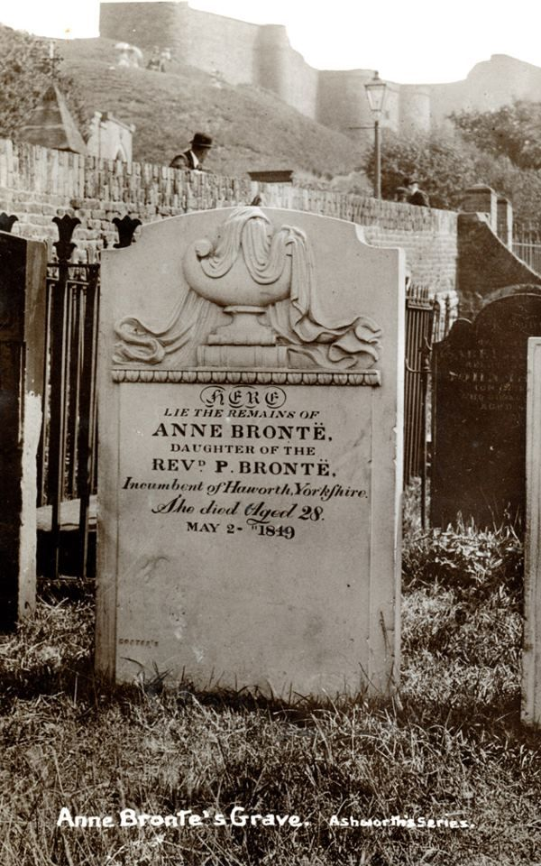 Anne Bronte's Grave, St. Mary's Church, Scarborough, England. A vintage photo of the grave; note bowler hat on man and street light in background. Anne's original gravestone was refaced three years after her death, when Charlotte (her sister) returned to discover five errors on it. The other mistakes were corrected but the age was not. Anne was 29 when she died. In 2011, The Bronte society placed a plaque on the site of the grave, with the correction.