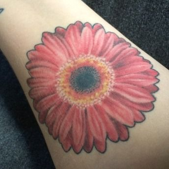 Gerbera Daisy tattoo based off of photos from my wedding bouquet.