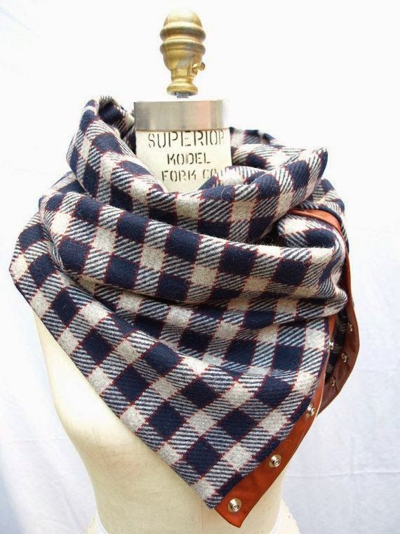 Plaid cowl with leather and metal snap detail.