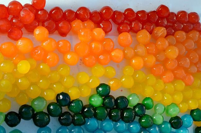 colored boba pearls for sensorial play... like water beads, but safe for babies who still sample!