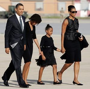 Michelle Obama at 50: July 10, 2009: President Barack Obama and family arrive at an airport, near