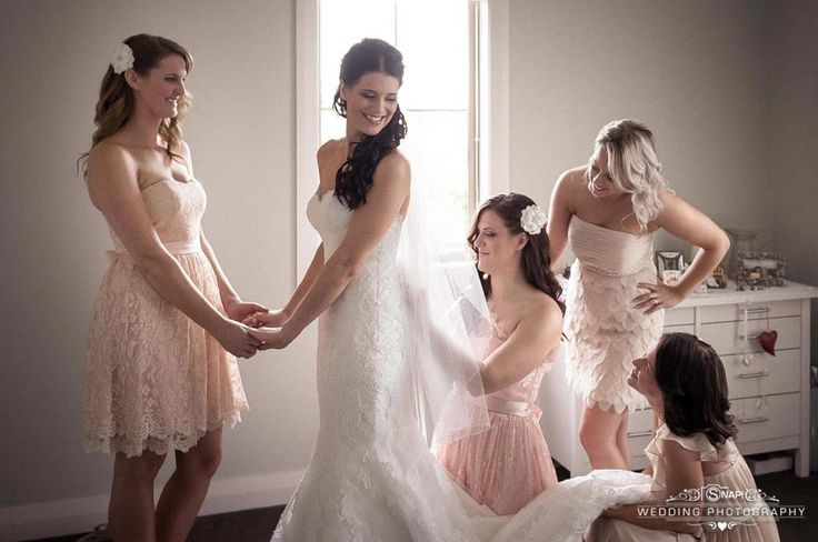Bridal preparations with the bridesmaids and maid of honour.  More wedding photography by Anthony Turnham at www.snapweddingphotography.co.nz