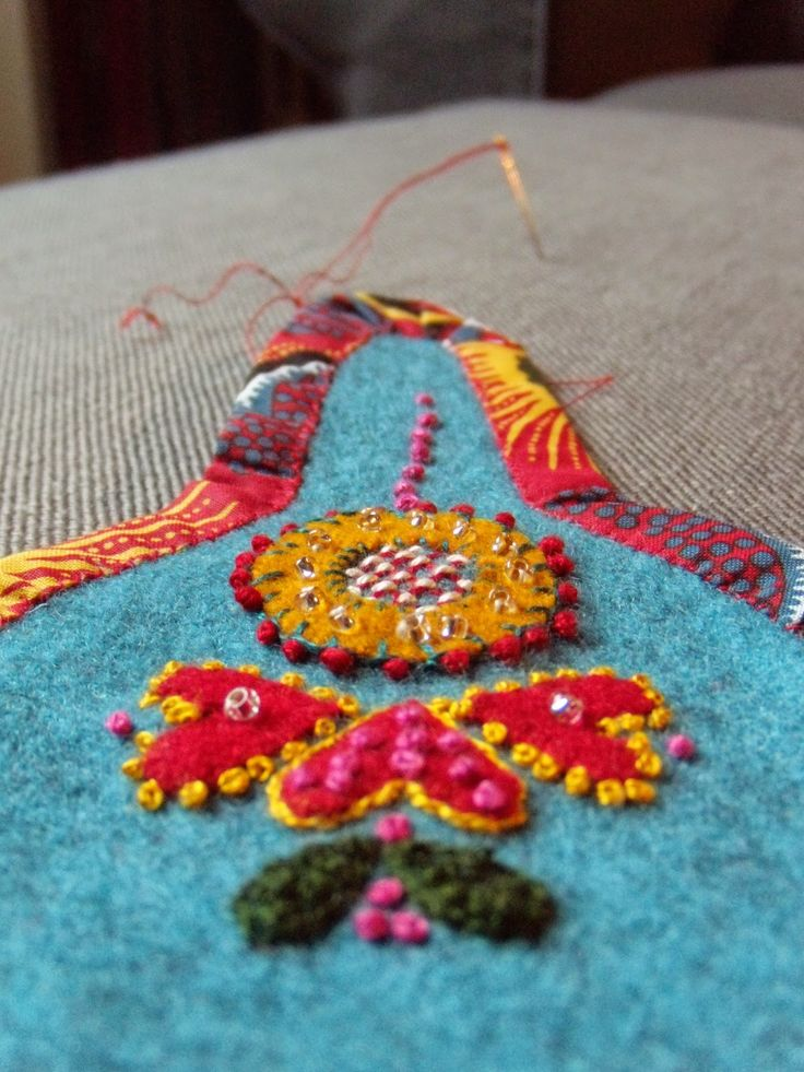 case for pins and needles - embroidery on felt. I love it how she has taken the colors from the fabric binding