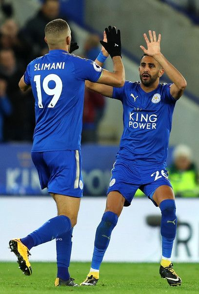 Islam Slimani Photos - Riyad Mahrez of Leicester City celebrates scoring the first Leicester goal with Islam Slimani of Leicester City during the Premier League match between Leicester City and West Bromwich Albion at The King Power Stadium on October 16, 2017 in Leicester, England. - Leicester City v West Bromwich Albion - Premier League