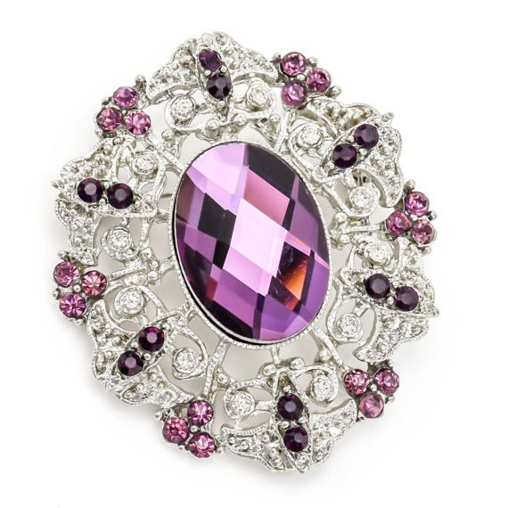 This listing is for a purple crystal rhinestone brooch. Great for wedding decorations, brooch bouquet, invitations, ring pillow, wedding cake and much more. * Quantity: 1 pc * Measure : 1 7/8 W x 2 1/4 H * Stones color: purple acrylic rhinestone crystal * Back: pin back * Metal color: