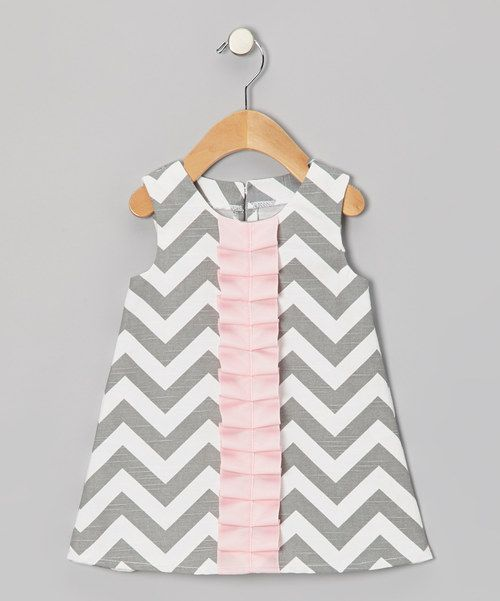 Jazzed with zigzags and a colorful frill accents, this soft cotton piece adds a lively touch to a little lady's wardrobe. The half-zipper in back makes dressing as easy as pie.100% cottonMachine wash; tumble dryImported