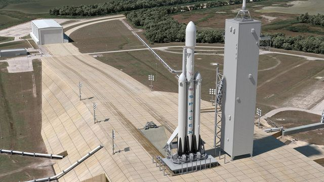 A SpaceX Falcon Heavy rocket is shown atop Pad 39A of NASA's Kennedy Space Center in Florida in this artist's concept. Elon Musk says the rocket will launch his own Tesla Roadster on its maiden flight in January 2018.