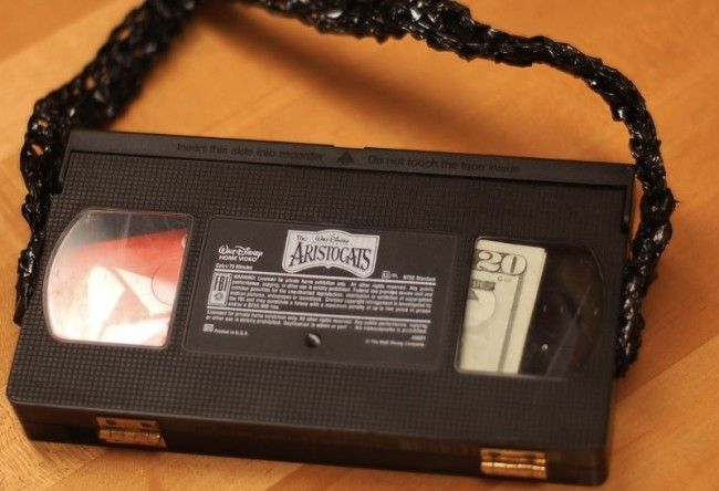 Clutch purse made from a VHS tape, with crocheted tape strap