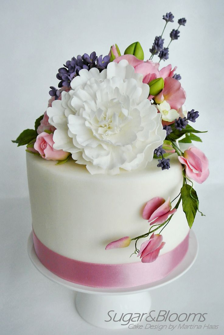 Mini wedding cake with sugar flowers in pink and lavender tones - english roses, lavender, sweet peas, peony and filler flowers made out of sugar paste, gum paste