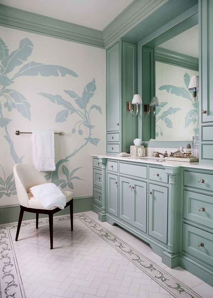 Dining Room Decorating Ideas. Blue palm leaf wallpaper in a bathroom by McCann Design Group.