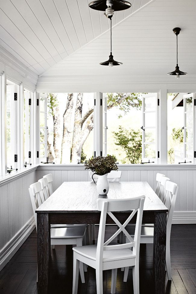 Veranda converted to a dining room, timber windows