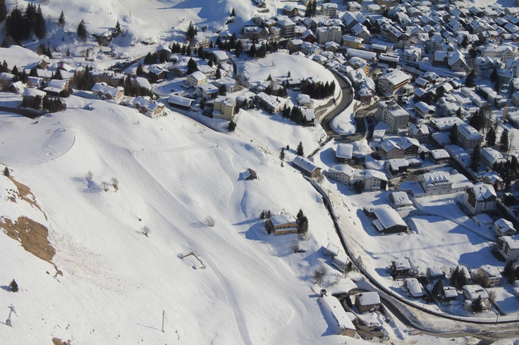 Aerial view from our lodge and hostel. We are located just next to the piste and chairlift. Only few meters walking to the railwaystation or village center. Ski in and ski out:-)