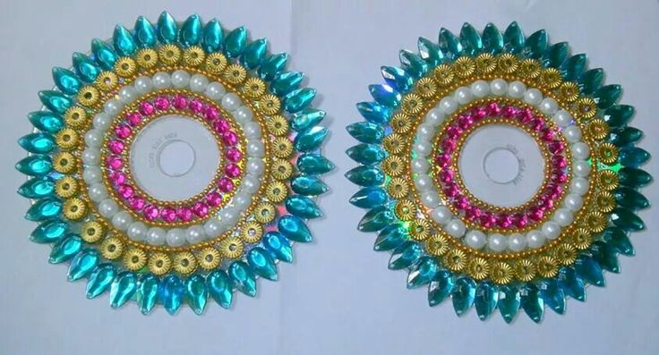 Diya decoration on cd candles rangoli pinterest for Hand work from waste materials