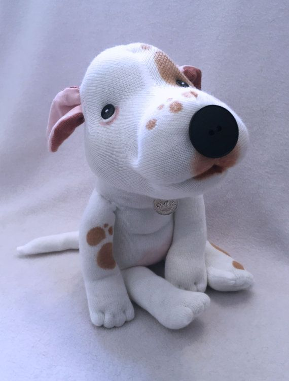 Born: March 21, 2016 Rowley is a one and only. A true original character. A snugglier blockhead youll never meet. Measures about 12 from head to paws. Rowley is one of a kind, and handmade from all new materials, including socks, buttons, and high quality stuffing. This sweet Pittie boy comes with an artist signed and numbered hangtag. --IMPORTANT NOTE-- Original Sock Dogs are one of a kind, unique artist collectibles and are not intended for children 12 and under due to their small…