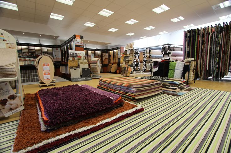 Carpets rugs and vinyl galore new flooring showroom for Showroom flooring ideas