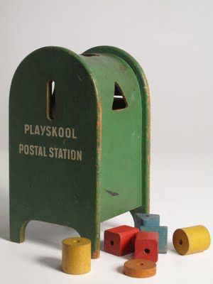 This is the Vintage Playskool Postal Station that I had as a child. Before mail boxes were red and blue. The very first blocks or beads exploring geometric shapes