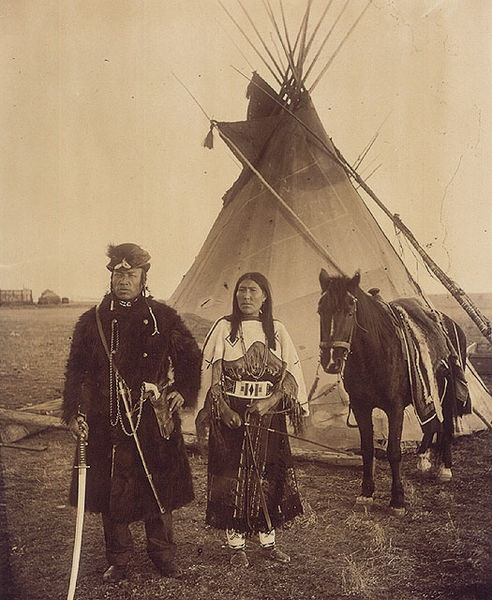 Dog Child, a North West Mounted Police scout, and his wife, The Only Handsome…