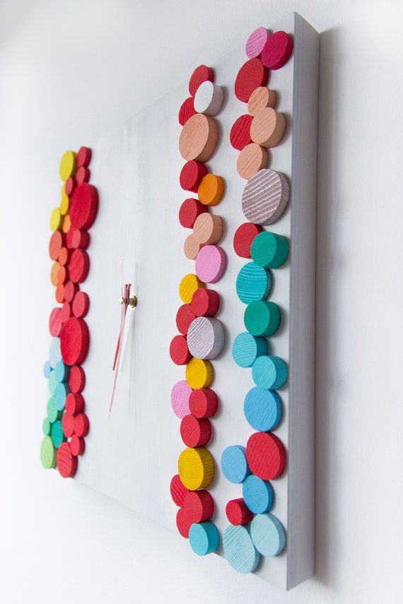 Happy Bubbles / Wood wall clock / Geometric mosaic / Unique design Liliana Stoica ▀▄ ▀▄ ▀▄ Collection - limited edition Massive wood cut in geometrical pattern, manual painted and assembled with an abstract vision for shapes and shadows. The collection its a spring festive of colors,