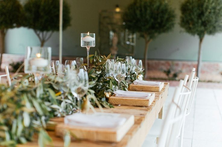 Romantic greenery and gold accents at Olive Rock. Green runners, candles, modern vases and a beautiful bride all captured by Jenni Elizabeth.