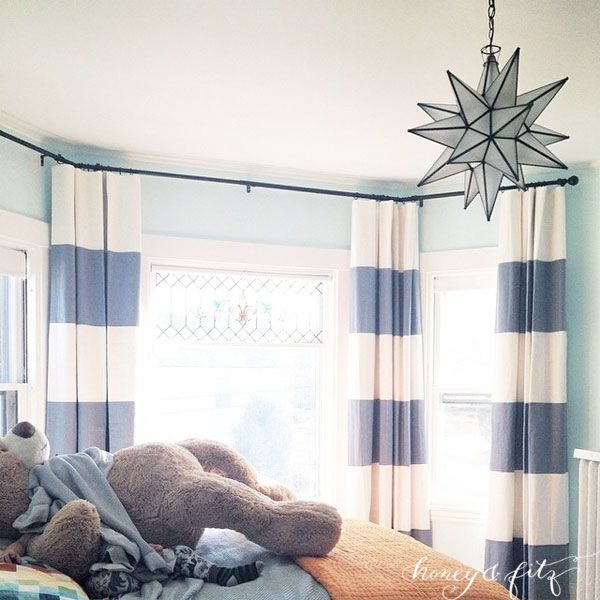 Benjamin Moore Barely Teal Paint with blue striped curtains