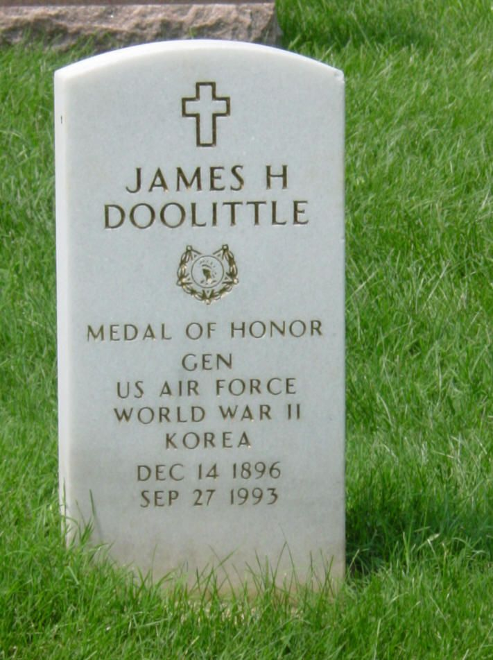 """Grave site at Arlington of General James Harold """"Jimmy"""" Doolittle, USAF. An American aviation pioneer. Doolittle served as an officer in the United States Army Air Forces during the Second World War. He earned the Medal of Honor for his valor and leadership as commander of the Doolittle Raid on Japan during the early months of the war while a lieutenant colonel."""