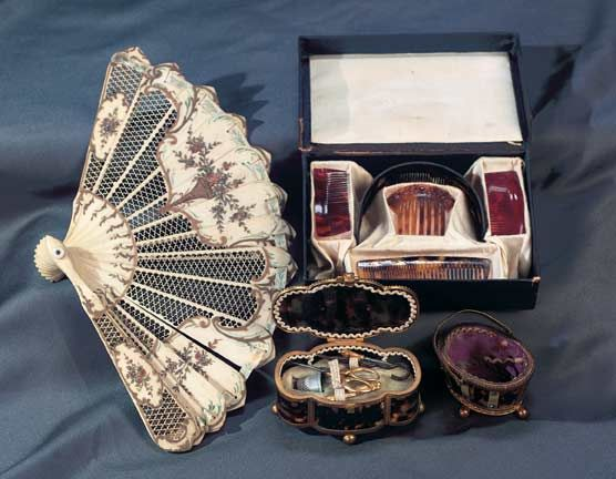 """Superb Hand-Painted Bone Folding Fan 5"""" (13 cm.) l. The sixteen-blade folding fan has intricately-cut fretwork blades with curved tops and are connected by a hand-painted ivory silk ribbon. Each blade is also hand-painted in an 18th century design which,when the fan is opened,reveals two urns of beautiful flowers. Excellent condition. French,early 19th century"""