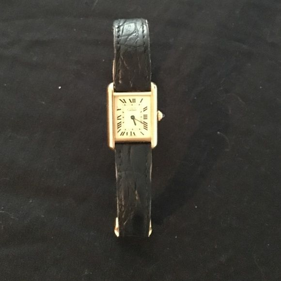 Cartier Watch Classic must de Cartier watch with black leather strap.  Gold plated. Very small nick in the strap but otherwise in great shape.  Face is perfect. Cartier Accessories Watches