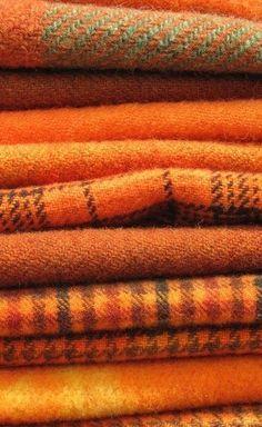 Orange flannel blankets layered like fallen Autumn leaves