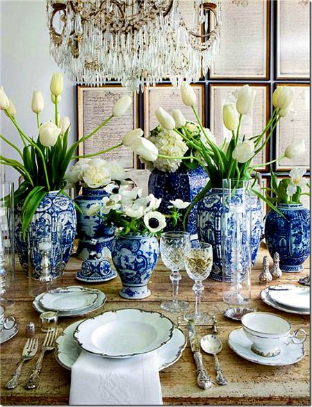 dining table with ginger jars filled with white flowers - beautiful