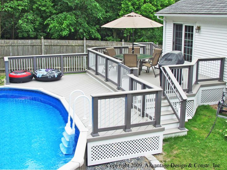 Attractive Above Ground Pool Deck For Enjoyable Home Exterior Ideas: Splendid Oval Above Ground Pool Deck Ideas With White Pool Ladder And Brown Chair Dinning Set With Brown Umbrella Design