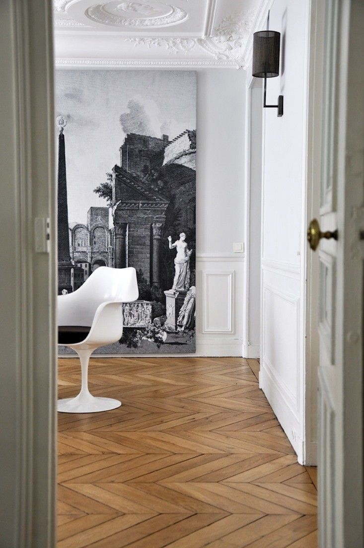 Stephanie Ross's Bedroom in her Paris Apartment. The black wall lamp is handmade by a Parisian artist.
