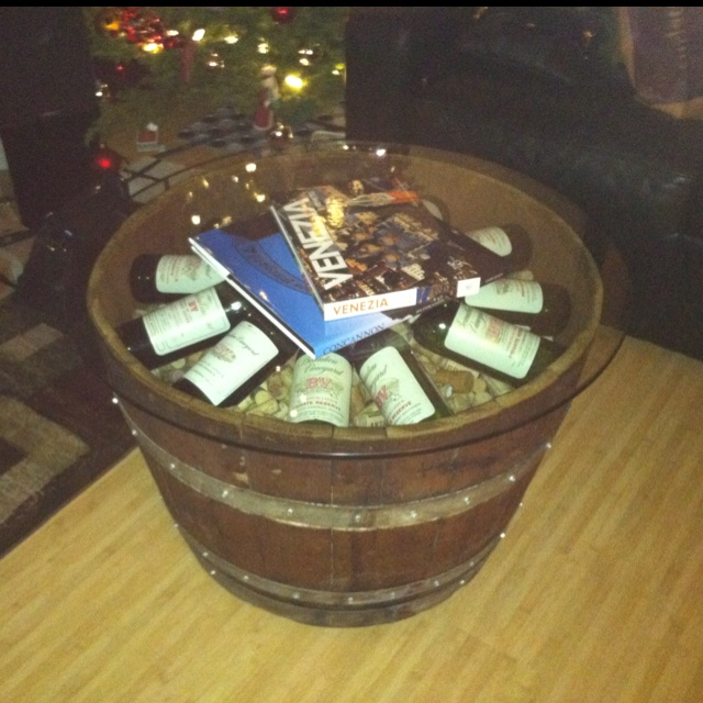Homemade wine barrel coffee table with corks and wine displayed under glass  top! - 25+ Best Ideas About Wine Barrel Coffee Table On Pinterest