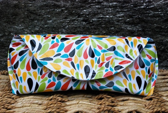 Sunglasses case in cotton laminate fabrics, lined in nylon, padded for support, magnetic snap, $22