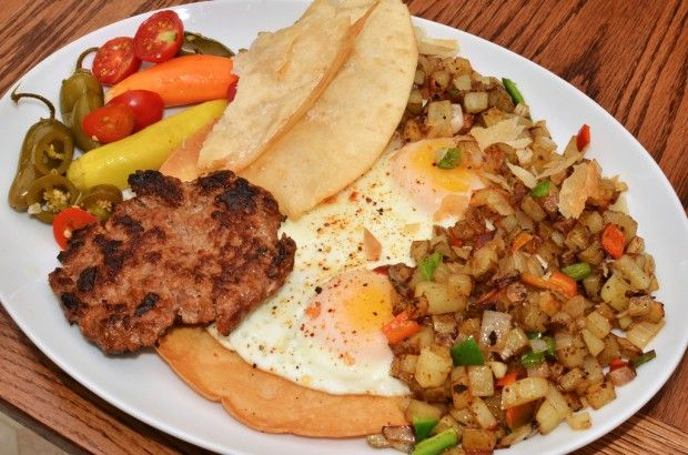 Mmm... breakfast pr0n - hash browns with chilies, eggs up, chorizo ...