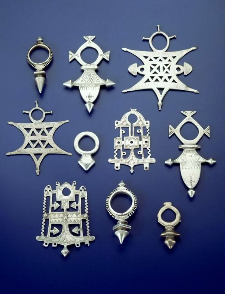 Africa | Collection of Tuareg 'crosses' and amulets | Silver, silver tone metal | Collection Royal Museum for Central Africa, Tervuren.