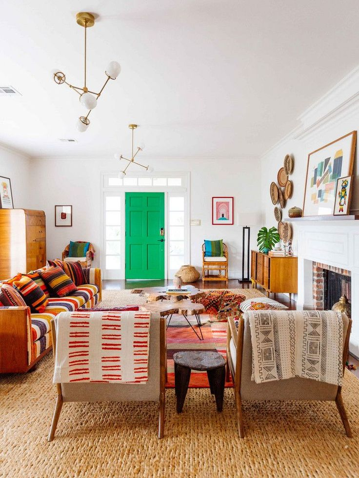 A Tan, Orange, And Red Living Room With Bohemian Accents And Textiles  #homedecorlivingroomcolorinspiration