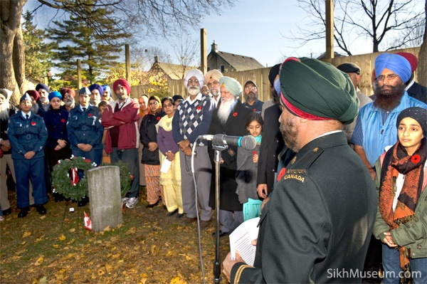Captain Prabhjot Singh Dhanoa, 25th Field Ambulence, Canadian Forces addresses the audience at the 2009 Sikh Remembrance Day Ceremony sponsored by SikhMuseum.com