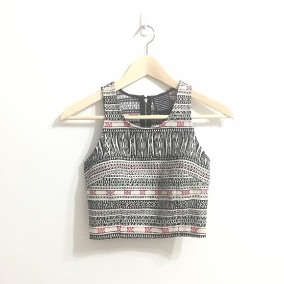 """ALICE IN THE EVE Tribal Crop Tank Top A must-have crop tank for that edgy, bohemian girl! Cotton-Polyester Blend - A geometric, tribal-inspired print, and a racerback. Pair with soft shorts and strappy sandals for a casual warm weather look. Measurements ~ 11"""" bust 9"""" waist ALICE by Temperley Tops Tank Tops"""