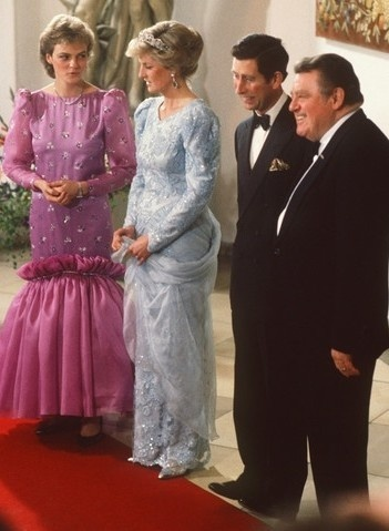 Uncharacteristically playing with her gown. Princess Diana