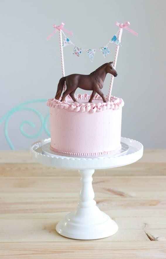 little pink cake with horse