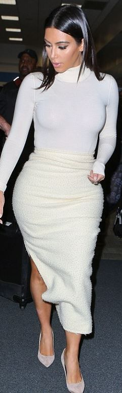 Kim Kardashian�s white turtleneck top and cream skirt that she wore in San Francisco